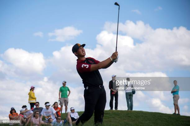 Rico Hoey of the University of Southern California tees off during the Division I Men's Golf Individual Championship held at Rich Harvest Farms on...