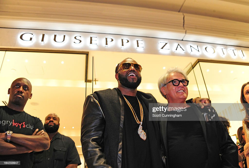 <a gi-track='captionPersonalityLinkClicked' href=/galleries/search?phrase=Rico+Love&family=editorial&specificpeople=691968 ng-click='$event.stopPropagation()'>Rico Love</a> and Giuseppe Zanotti attend the Opening Party for the Giuseppe Zanotti Store at Phipps Plaza on October 11, 2013 in Atlanta, Georgia.