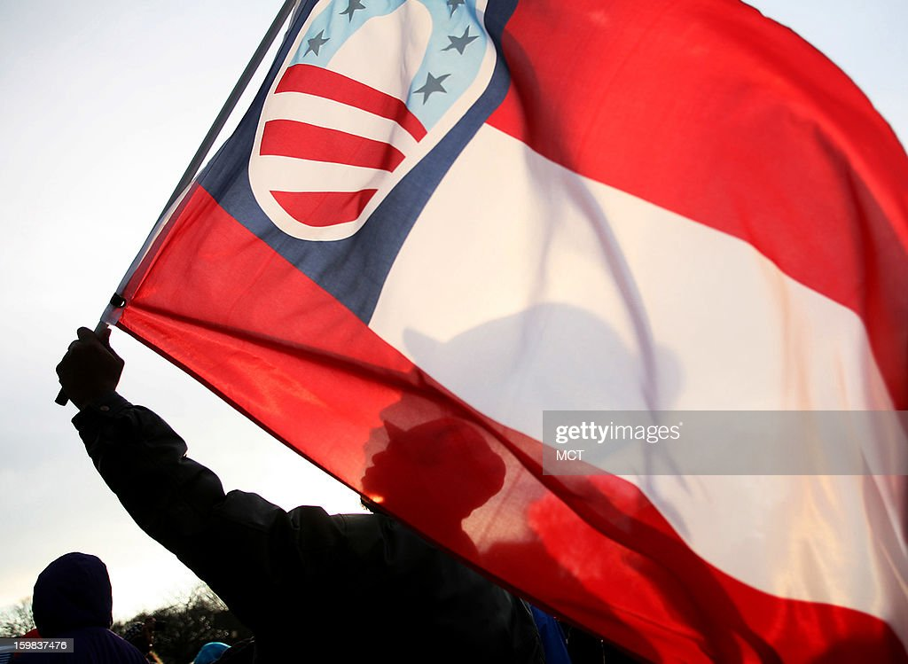 Rico Marlow, 40, of Trinidad & Tabago, currently living in Washington, D.C., holds an Obama hope flag during the inauguration ceremonies Monday, January 21, 2013 in Washington, D.C.