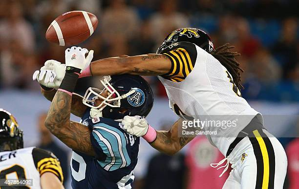 Rico Murray of the Hamilton TigerCats causes pass interference on Maurice Mann of the Toronto Argonauts during their game at Rogers Centre on October...