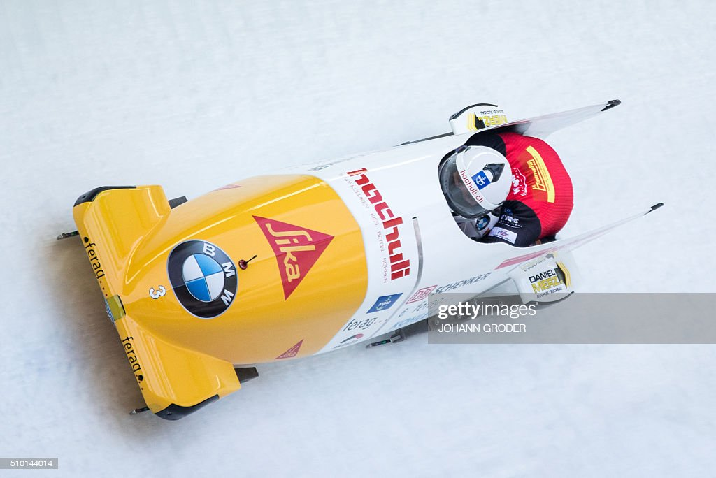 Rico Peter and Thomas Amrhein of Switzerland compete during the third run of the two-men Bobsleigh event of the Bobsleigh and Skeleton World Championships in Innsbruck/Igls, Austria, February 14, 2016. / AFP / APA / Johann Groder / Austria OUT