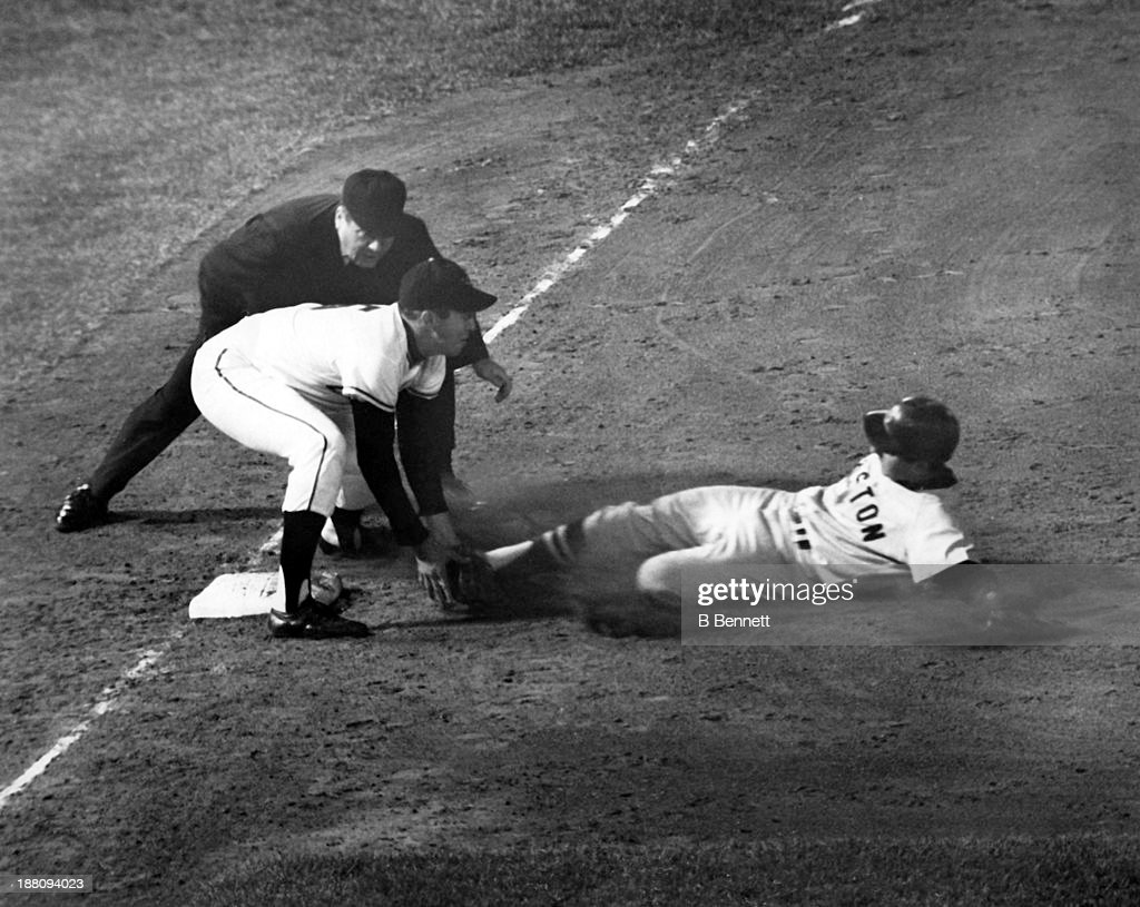 Rico Petrocelli #38 of the Boston Red Sox is tagged out by third baseman <a gi-track='captionPersonalityLinkClicked' href=/galleries/search?phrase=Brooks+Robinson&family=editorial&specificpeople=213977 ng-click='$event.stopPropagation()'>Brooks Robinson</a> #5 of the Baltimore Orioles as umpire <a gi-track='captionPersonalityLinkClicked' href=/galleries/search?phrase=John+Rice&family=editorial&specificpeople=91246 ng-click='$event.stopPropagation()'>John Rice</a> waits to make the call on April 24, 1965 at Memorial Stadium in Baltimore, Maryland.