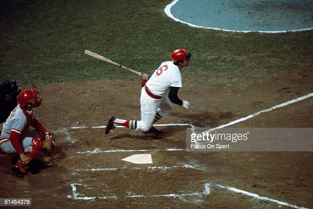 Rico Petrocelli of the Boston Red Sox starts his run after hitting the ball against the Cincinnati Reds during the World Series at Fenway Park on...