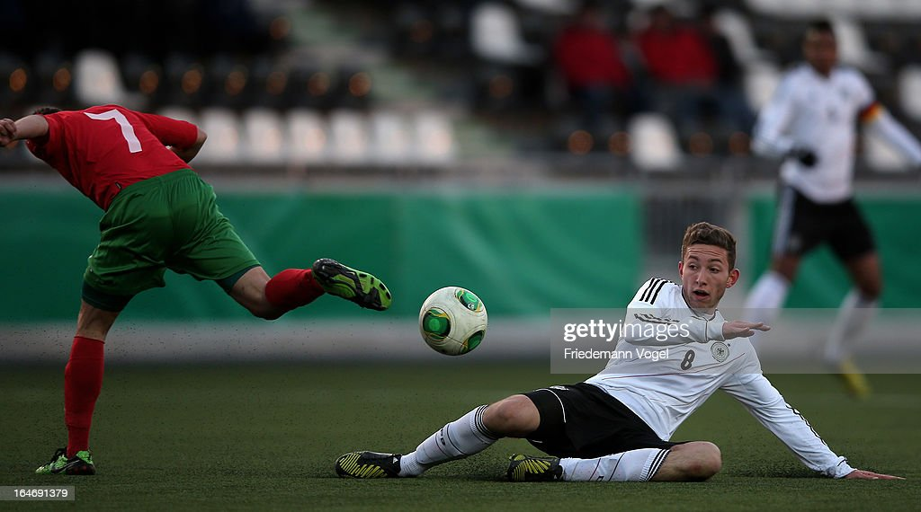 Rico Preissinger (R) of Germany and Emil Dobrinov Petrov (L) of Bulgaria battle for the ball during the UEFA Under17 Elite Round match between Germany and Bulgaria at Toennies-Arena on March 26, 2013 in Rheda-Wiedenbruck, Germany.
