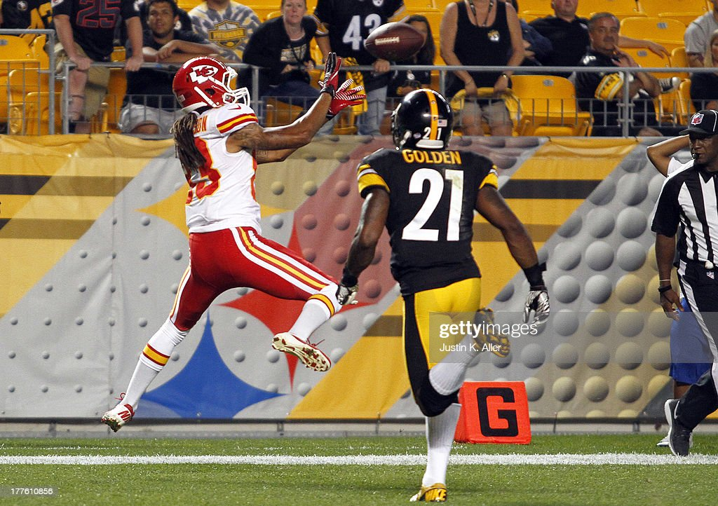 Rico Richardson #83 of the Kansas City Chiefs catches a fifteen yard touchdown pass to win the game against Robert Golden #21 of the Pittsburgh Steelers in overtime during the game on August 24, 2013 at Heinz Field in Pittsburgh, Pennsylvania.