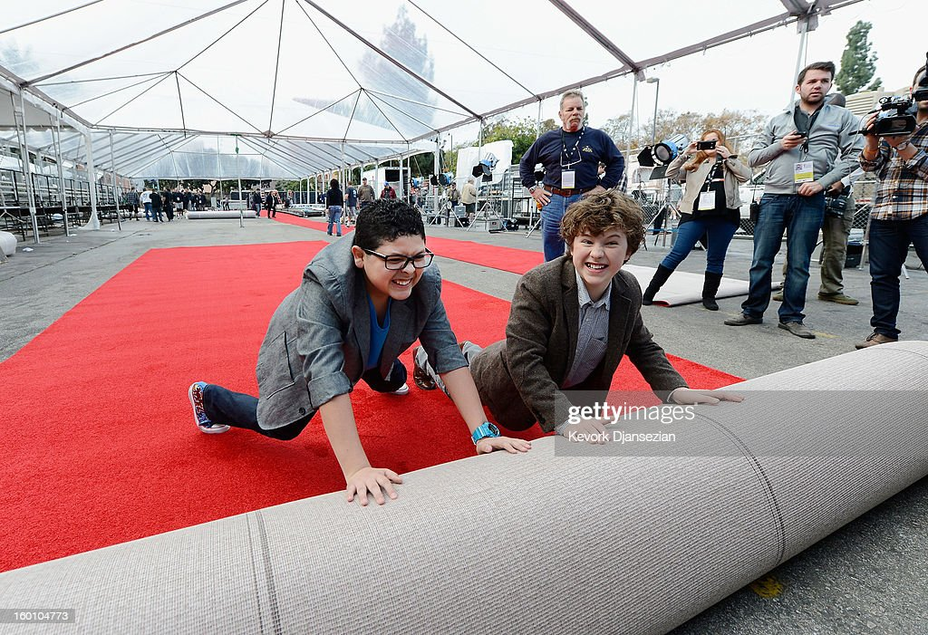 Rico Rodriguez (L) and <a gi-track='captionPersonalityLinkClicked' href=/galleries/search?phrase=Nolan+Gould&family=editorial&specificpeople=5691358 ng-click='$event.stopPropagation()'>Nolan Gould</a> (R) of 'Modern Family' roll out the red carpet during the 19th Annual Screen Actors Guild Awards red carpet roll out and presenter rehearsals at The Shrine Auditorium on January 26, 2013 in Los Angeles, California.