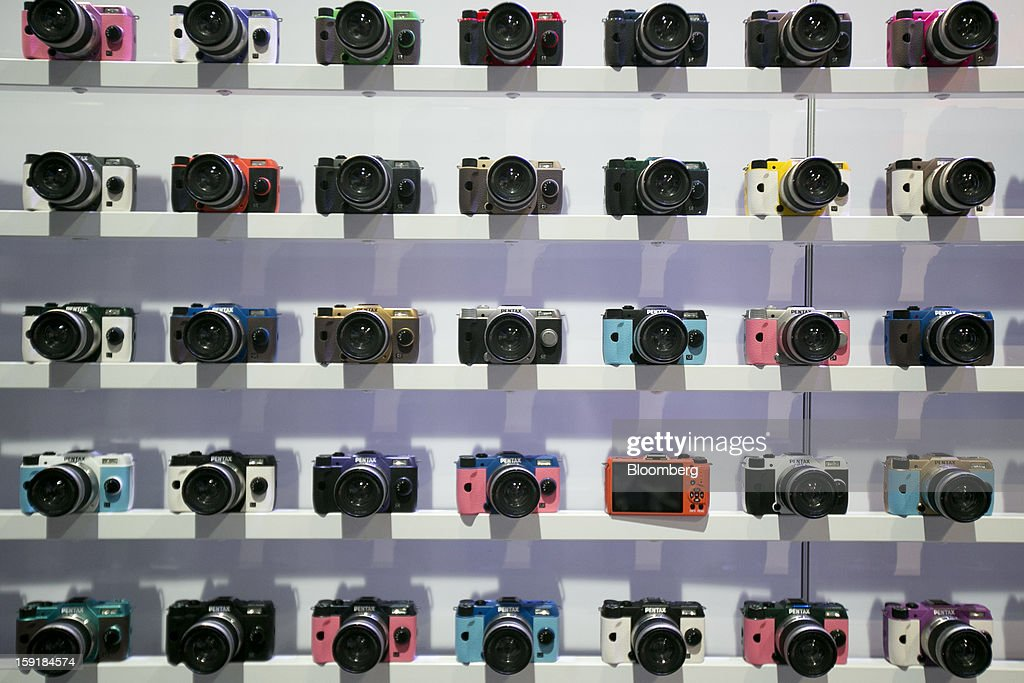 Ricoh Co.'s Pentax cameras sit on display during the 2013 Consumer Electronics Show in Las Vegas, Nevada, U.S., on Wednesday, Jan. 9, 2013. The 2013 CES trade show, which runs until Jan. 11, is the world's largest annual innovation event that offers an array of entrepreneur focused exhibits, events and conference sessions for technology entrepreneurs. Photographer: Andrew Harrer/Bloomberg via Getty Images