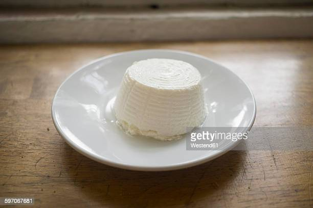 Ricotta cheese on saucer