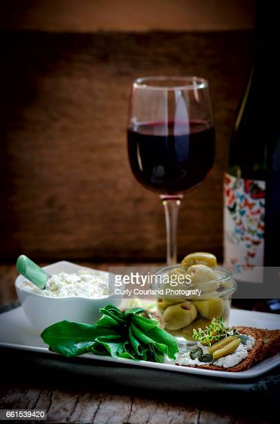 Ricotta with herbs, olives, wholegrain crispbread and red dry wine