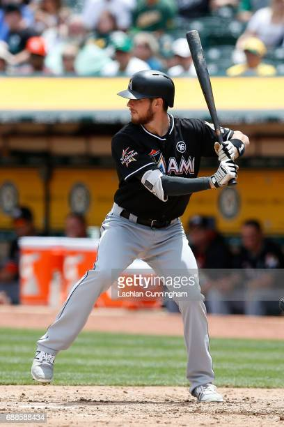 T Riddle of the Miami Marlins at bat in the third inning against the Oakland Athletics at Oakland Alameda Coliseum on May 24 2017 in Oakland...