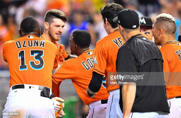 Riddle of the Miami Marlins celebrates a walk off homer with teammates in the ninth inning during the game between the Miami Marlins and the New York...