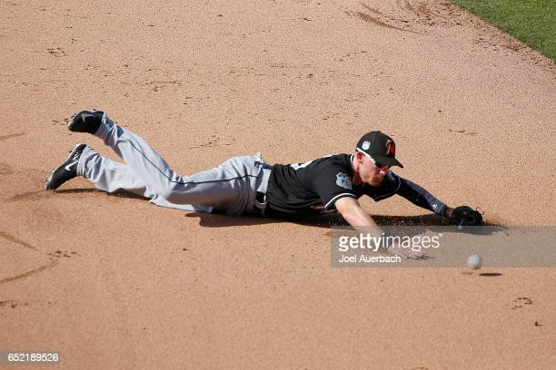 T Riddle of the Miami Marlins knocks down the ball hit by Tony Kemp of the Houston Astros in the eighth inning during a spring training game at The...