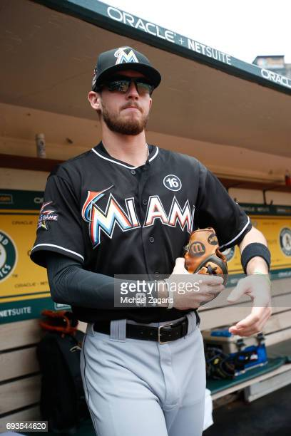 T Riddle of the Miami Marlins stands in the dugout prior to the game against the Oakland Athletics at the Oakland Alameda Coliseum on May 24 2017 in...