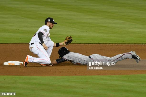 T Riddle of the Miami Marlins tags Dansby Swanson of the Atlanta Braves on a steal attempt in the 8th inning against the Miami Marlins at Marlins...
