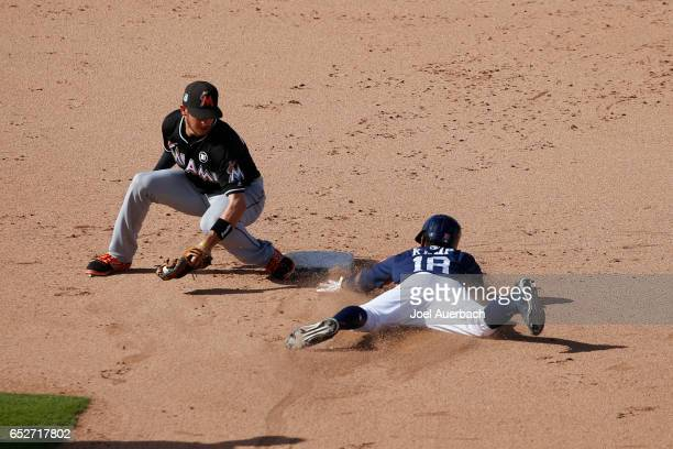 T Riddle of the Miami Marlins tags out Tony Kemp of the Houston Astros attempting to steal to end the eighth inning during a spring training game at...