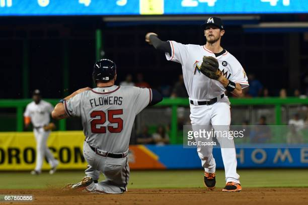 T Riddle of the Miami Marlins throws towards first base during the 5th inning against the Atlanta Braves at Marlins Park on April 12 2017 in Miami...