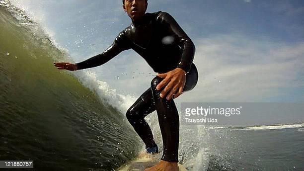 Ride along deep green wave