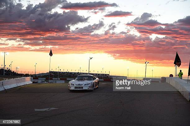 A ridealong car exits the track prior to the start of the NASCAR KN Pro Series West race at Tucson Speedway on May 2 2015 in Tucson Arizona