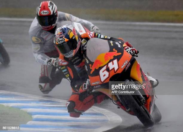 KTM rider Bo Bendsneyder of the Netherlands leads Honda rider Nakarin Atiratphuvapat of Thailand during the Moto3 class of the MotoGP Japanese Grand...