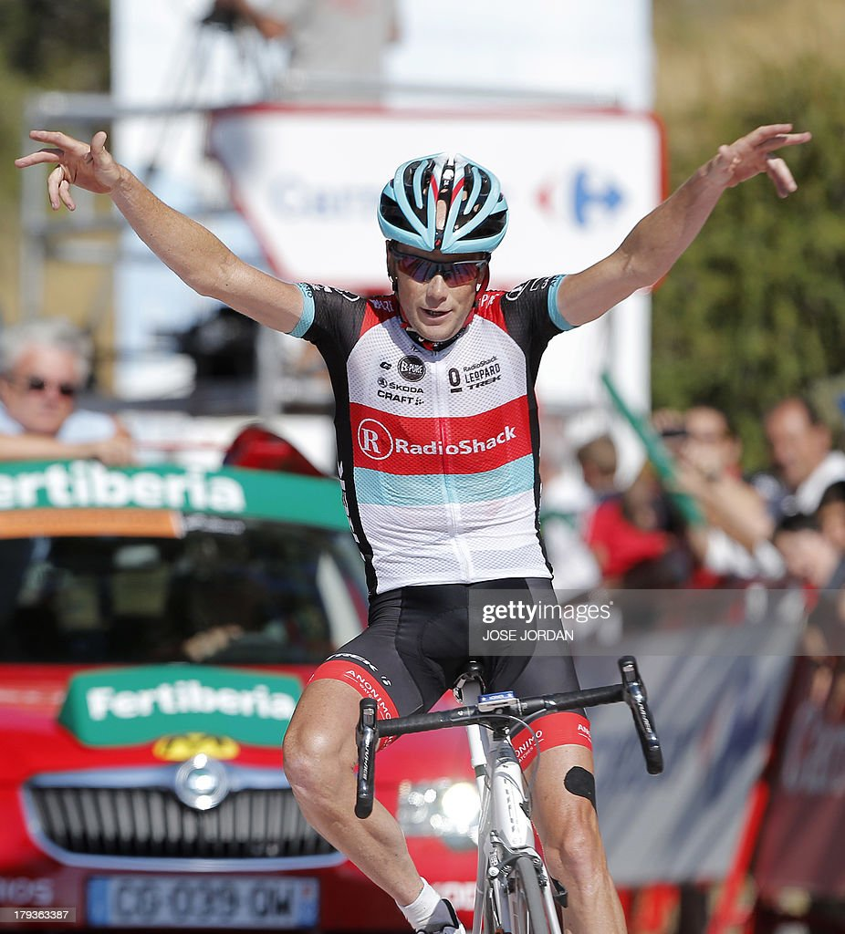 US rider Chris Horner (RadioShack) celebrates winning as he crosses the finish line on September 2, 2013 after the tenth day of the 68th edition of 'La Vuelta' Tour of Spain, a 186,8km stage between Torredelcampo and Alto de Hazallanas.