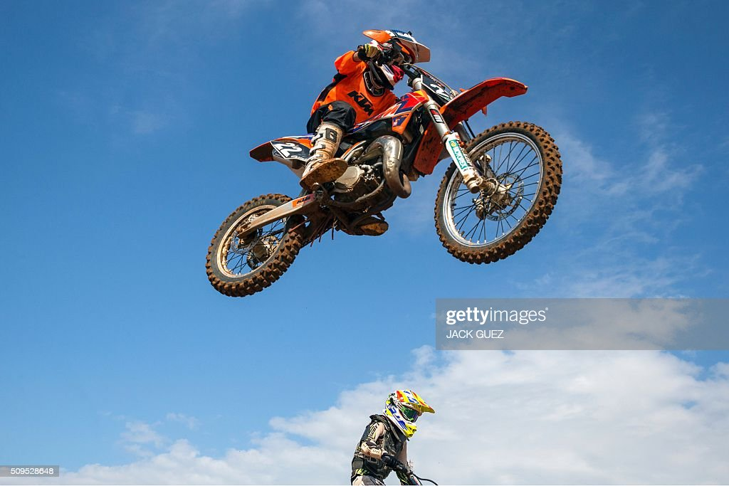 A rider comes off a jump during the inauguration of the MX Wingate Motocross track near the Israeli city of Netanya on February 11, 2016. / AFP / JACK GUEZ