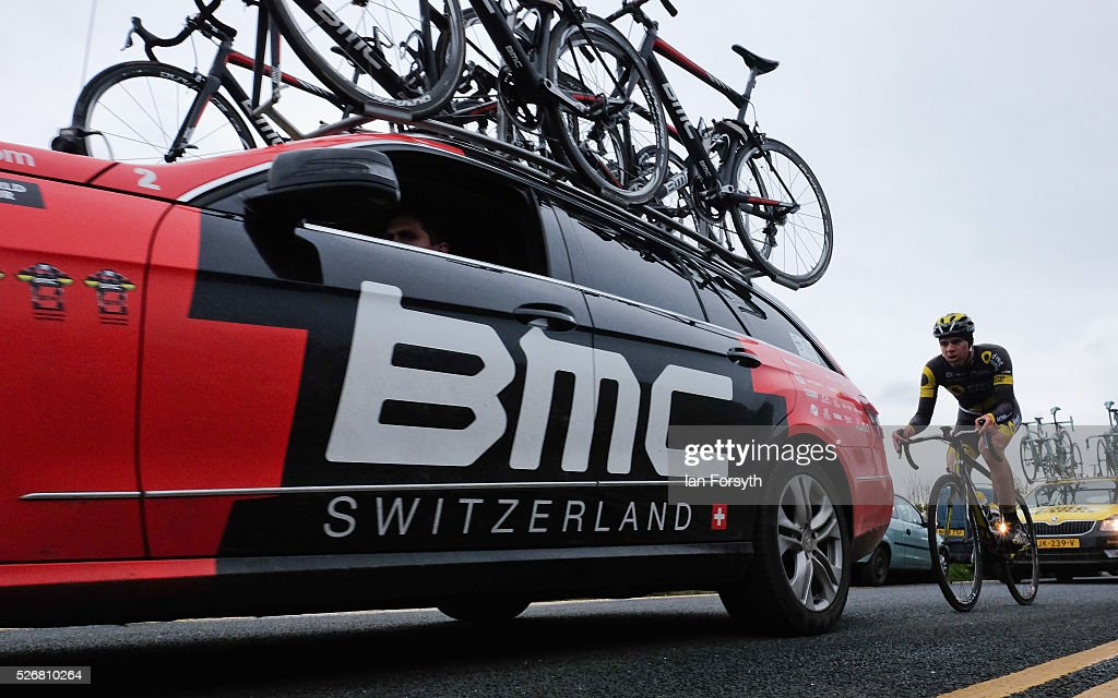 A rider competing in stage three of the Tour de Yorkshire cycle rides behind a BMC team car on May 1, 2016 in Whitby, England. Returning for a second year the hugely popular race has grown to be one of the most spectacular events in the British sporting calendar. Up to a million people have lined the route along the three stages of the race which ends today with the 198km Middlesbrough to Scarborough leg.