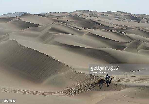 Rider crosses the dunes during the stage from Pisco to Nazca on day three of the 2013 Dakar Rally on January 7 2013 in Pisco Peru