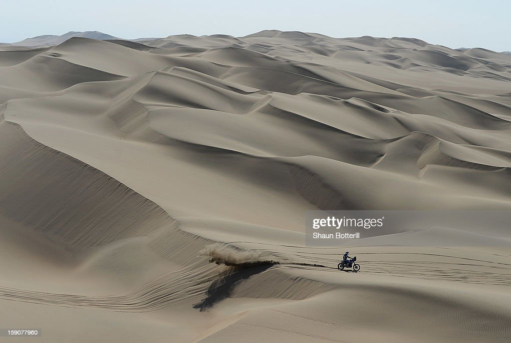 A Rider crosses the dunes during the stage from Pisco to Nazca on day three of the 2013 Dakar Rally on January 7, 2013 in Pisco, Peru.