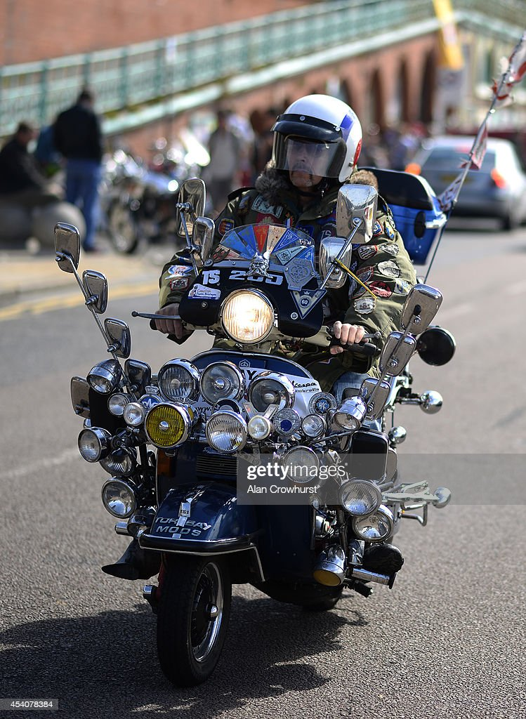 A rider cruises along the seafront during the Brighton Mod weekender on August 24, 2014 in Brighton, England. This August Bank holiday will see many Mods and their scooters return to their spiritual home of Brighton for the Mod Weekender event.