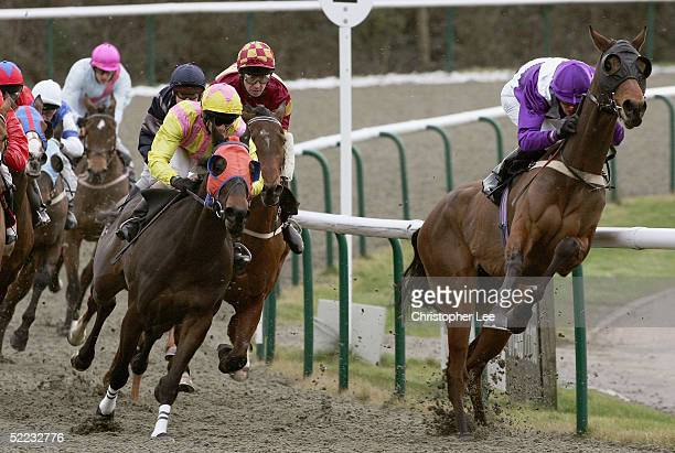 Rider D Nolan on Street Games jumps up on the final corner in The Be Lucky Online At footballpoolscom Selling Stakes at Lingfield Park Race Course on...