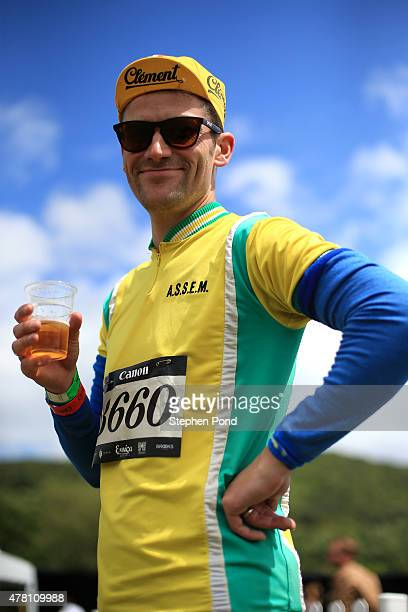 A rider enjoys a beer after finishing the 100 mile route of the Eroica Britannia on June 21 2015 in Bakewell England Eroica Britannia is a vintage...