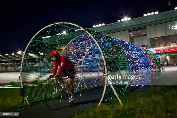 A rider enters the velodrome ahead of his race during Keirin races at Kawasaki Velodrome on July 11 2015 in Kawasaki Japan Keirin is a form of cycle...