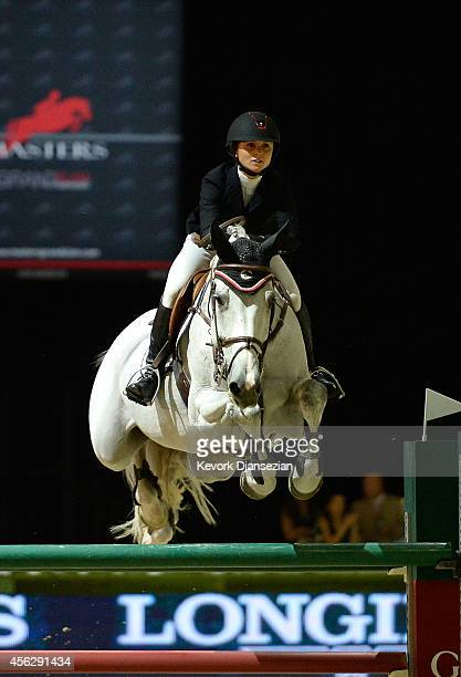 Rider Georgina Bloomberg rides Juvina en route to a third place finish during the Longines Grand Prix class as part of the Longines Los Angeles...