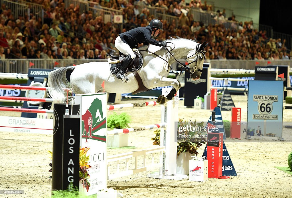 Rider Gerco Schroder of Germany rides Cognac Champblanc during the Longines Grand Prix class as part of the Longines Los Angeles Masters at Los Angeles Convention Center on September 28, 2014 in Los Angeles, California.