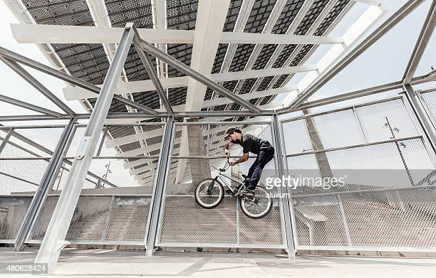 BMX rider in city jumping in Barcelona
