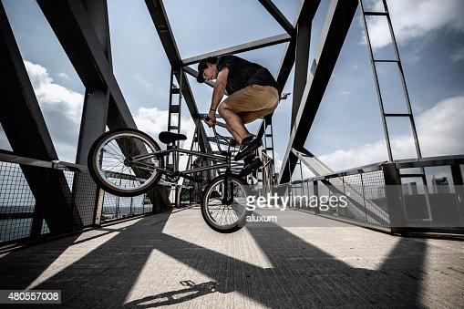 BMX rider in city jumping : Stock Photo