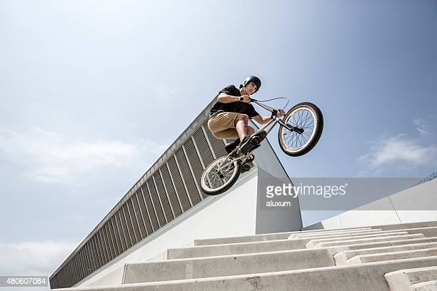 BMX rider in city jumping