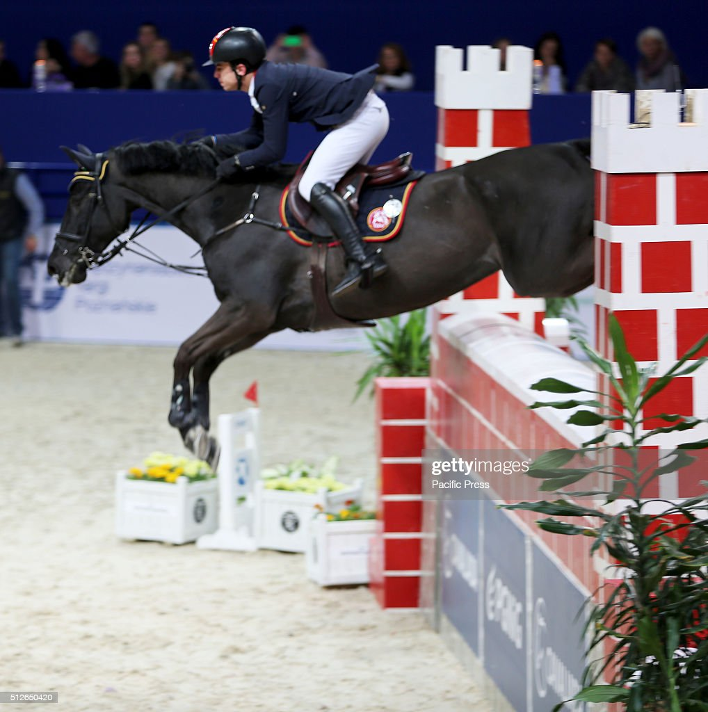 A rider is seen jumping the highest obstacle during the for Show pool horse racing