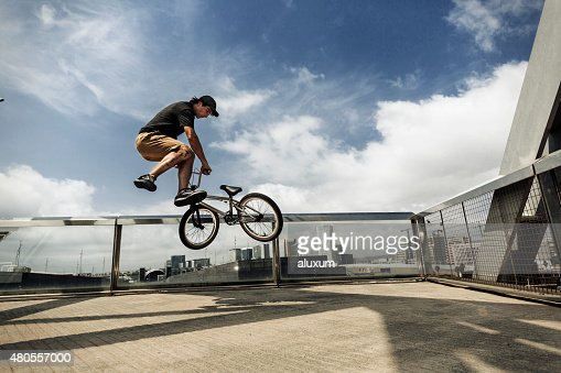 BMX rider jumping in the city : Stock Photo