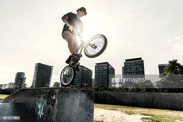 BMX rider jumping in urban environment
