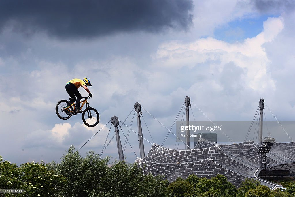 A rider jumps during a practice session for the mountain bike slopestyle competition on Day 2 of the X-Games at Olympic Parc on June 28, 2013 in Munich, Germany.