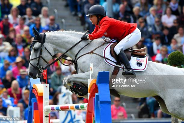 US rider Laura Kraut with her horse Zeremonie jumps over an obstacle during the Grand Prix of Aachen during the World Equestrian Festival CHIO in...