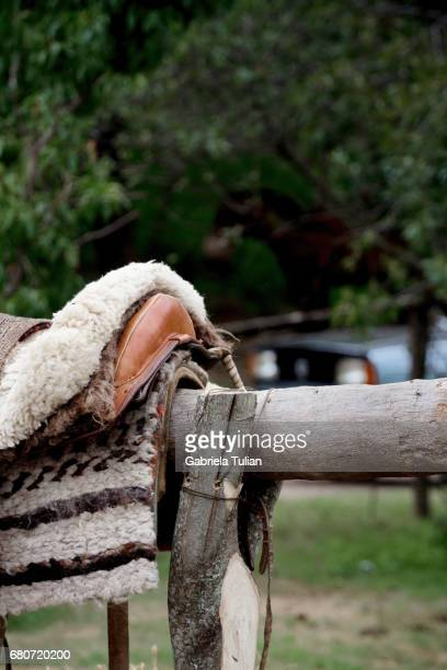 Rider Leather Saddles on rustic fence