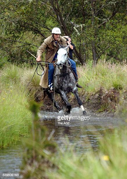 Rider Lincoln Adams crosses a creek before winning the 2005 Cattlemen's Cup in Junction Plain Alpine region The event attracts riders from around the...