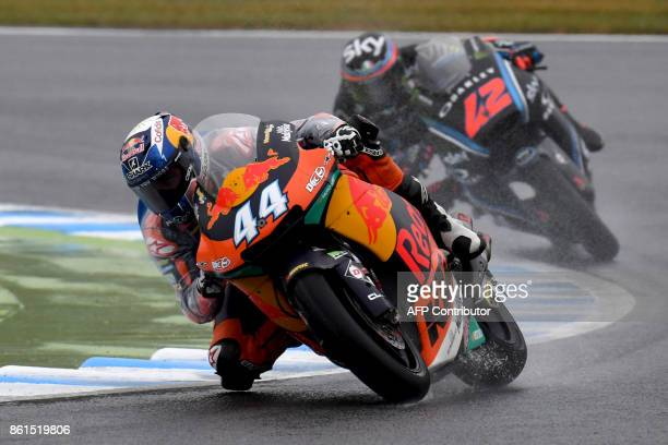 KTM rider Miguel Oliveira of Portugal leads Kalex rider Francesco Bagnaia of Italy during the Moto2class of the MotoGP Japanese Grand Prix at Twin...