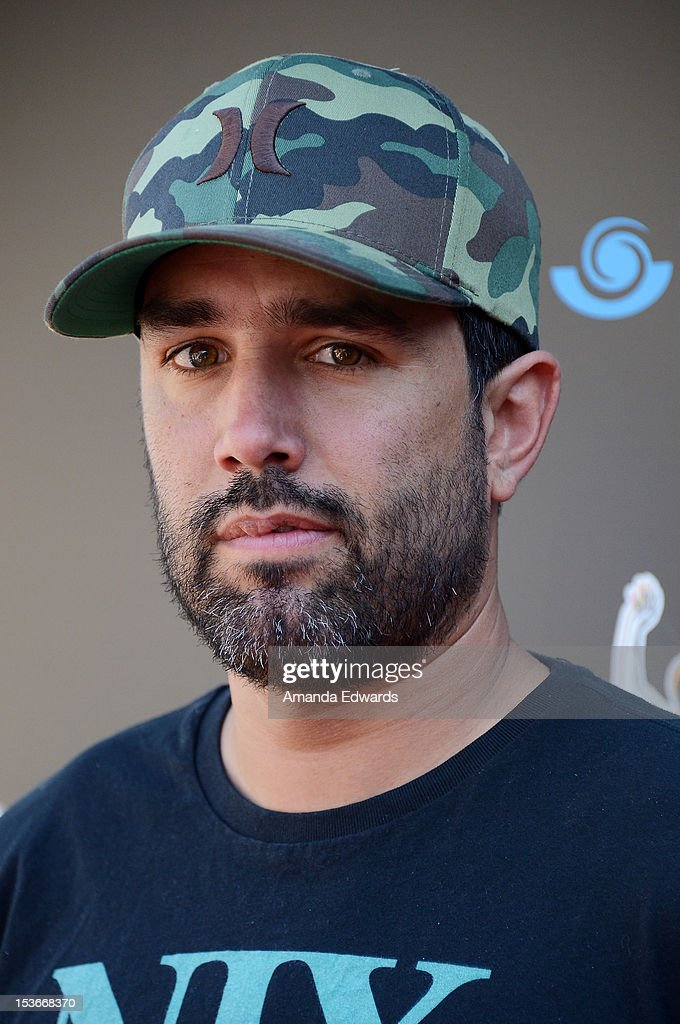 BMX rider Mike Escamilla arrives at the 9th Annual Stand Up For Skateparks Benefiting The Tony Hawk Foundation at a private residence on October 7, 2012 in Beverly Hills, California.