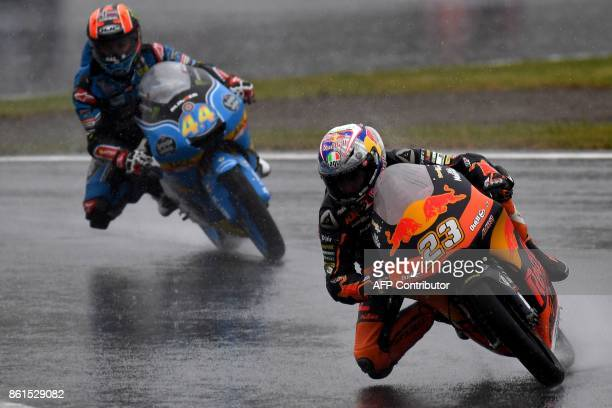 KTM rider Niccolo Antonelli of Italy leads Honda rider Aron Canet of Spain during the Moto3 class of the MotoGP Japanese Grand Prix at Twin Ring...