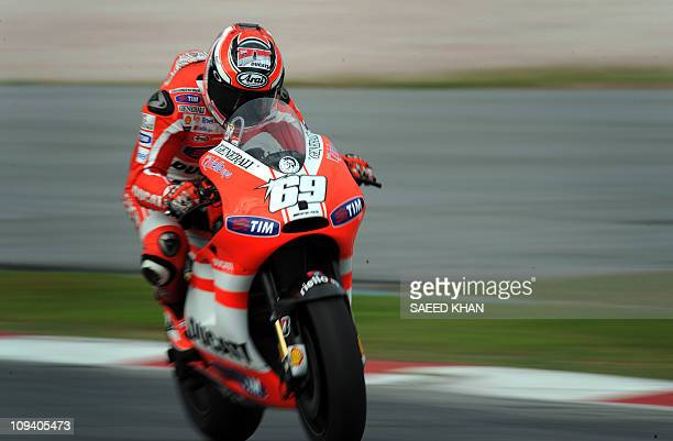 US rider Nicky Hayden of Ducati powers his bike during a MotoGP preseason second test run on the Sepang circuit near Kuala Lumpur on February 24 2011...