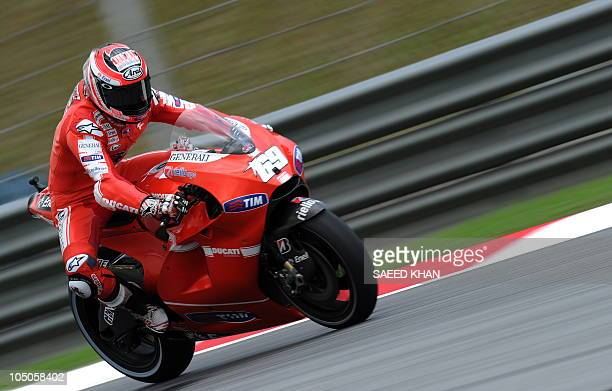 US rider Nicky Hayden of Ducati team powers is bike during the first free practice session at the Malaysian Grand Prix MotoGP race at Sepang on...
