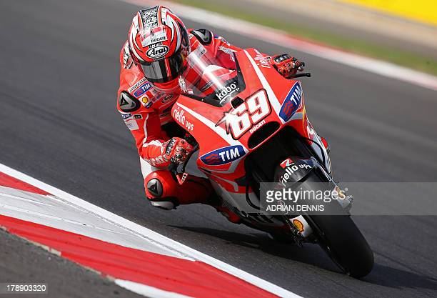US rider Nicky Hayden rides his Ducati during the Free Practice in the MotoGP at Silverstone in Northamptonshire on August 31 2013 AFP PHOTO / ADRIAN...